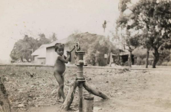 Nicaragua; boy at pump, 1945