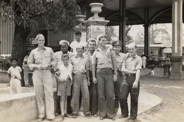 Nicaragua; mix of YMS crew and locals while on shore leave; Far left, front: Al B Wiles, Lieutenant (jg) (Skipper, Commanding Officer) of Jackson, MS; Dark officer's hat, right: Clint J Hill, Ensign (Communications Officer); 1945