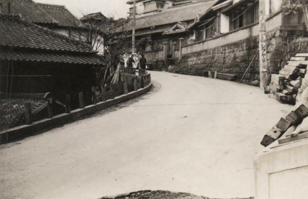 Sasebo streets with sailors in background; 1945
