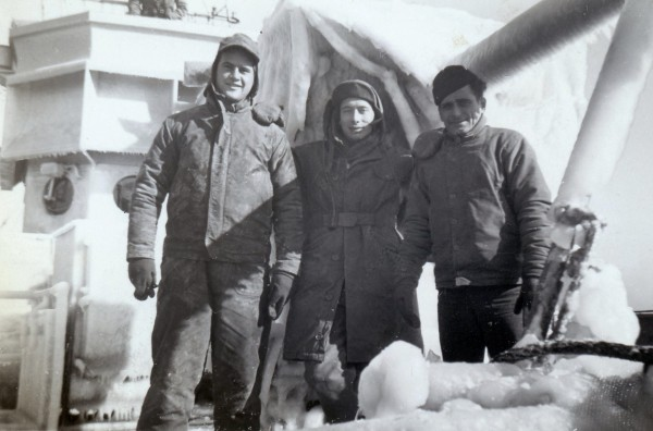 YMS-468 and crew; Left to right: Harold C Foster Jr., SoM3c (deckhand) of Birmingham, AL; Clint J Hill, Ensign (Communications Officer); Ambruzzi (Gunner's Mate, GM); ice accumulation while sweeping approaches to Chesapeake Bay, MD; Winter 1944